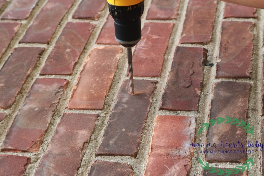 Drilling hole in brick