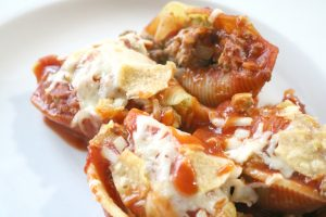 taco stuffed shells with melted cheese and toasty tortilla chips